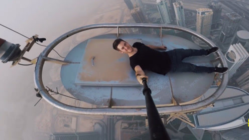 男子作死爬上迪拜高楼楼顶 全程紧张刺激