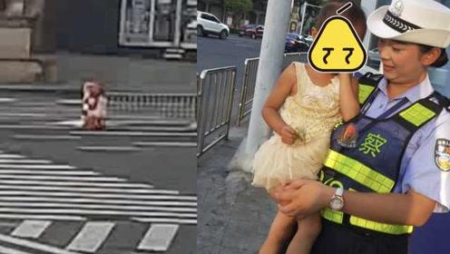 画面惊险!女孩闯进车流被困路中,女交警飞奔一把抱住