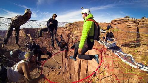牛人在高山峡谷创建平台,大玩高山跳伞,看着就觉得刺激!