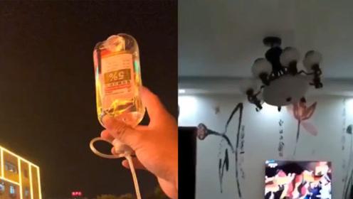 广西发生5.2级地震后:病人举吊针上街,有人淡定在家中唱歌录视频
