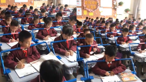 坐姿不对?不存在的!学生课桌上安装矫正器 头太靠下就会被横梁卡住