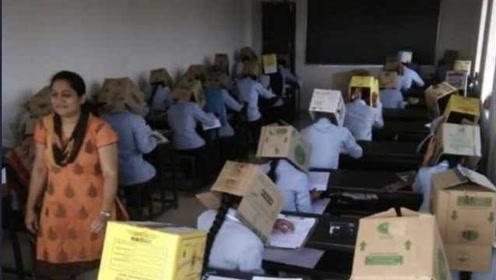 为防作弊,印度学生头戴纸箱参加考试