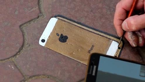 画家在地上画了个3D苹果手机,测试下路人的反应,结果都被骗了!