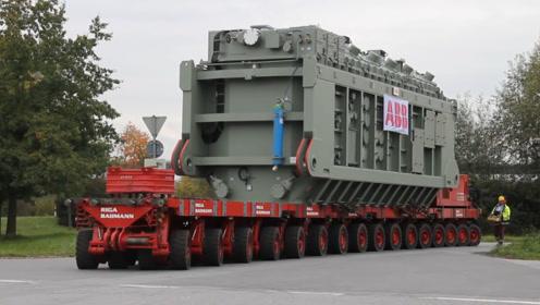 我国神级运输车,每个轮子能载30吨重量,每次运输量不低于千吨