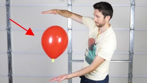 不用控制的气球自觉往你身上靠,不是魔术却很难以理解