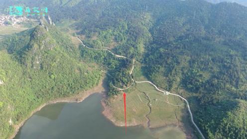 群山环抱面朝水库,据说此地形名为南蛇出洞,你觉得呢?