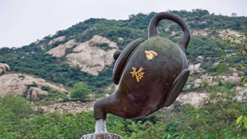 """青岛有一""""悬空茶壶"""",悬在半空中还能流水,你知道是何原理吗?"""