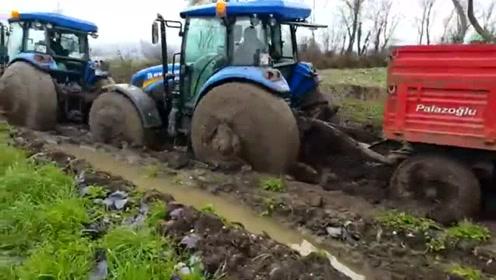 拖车拖拉载石车,泥土实在太滑,费了好大的劲才脱离苦海