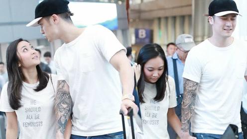 蒋劲夫与日本女友抵京 对视搭肩亲手
