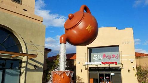 中国街头悬空茶壶流水不断,老外以为是魔术,感叹中国人太聪明了