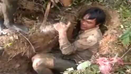 男子俯身地面洞口让人不解,结果挖出来的东西让所有人尖叫!