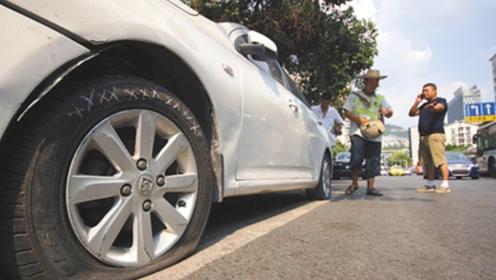 霸占私人停车位2天,轮胎被划破三个,女车主怒斥车位主人!