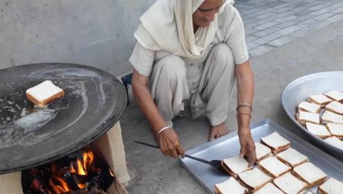 60岁土豪老太村里免费做小吃,200个三明治,133孩子吃到撑