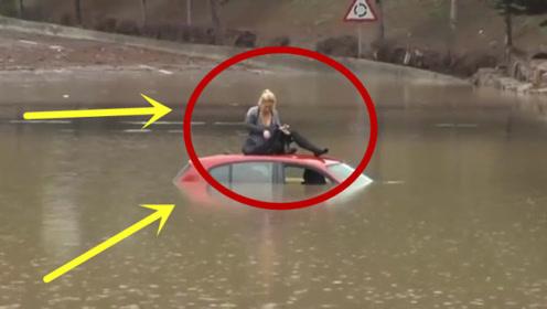 女子被困洪水等待救援,表情淡然冷静,这心理素质太牛了!