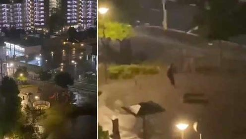 不顾撤离警告,东京男子超强台风中孤独荡秋千