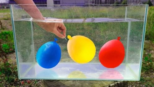 拿水气球放在水中,用力扎破后,慢镜头看到的画面实在太减压了