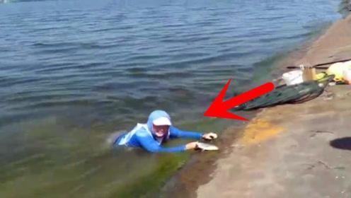 为了一条鱼真是拼了,女孩直接扑向水里,命都不要了?