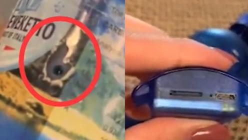 女游客沙滩游玩捡到饮料瓶,定睛一看里面竟藏有针孔摄像头