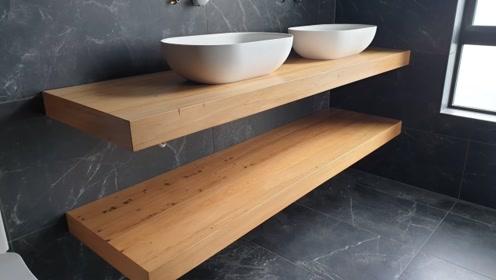 作为一个木工,能自己动手都不花钱买,洗澡间这两块木板做的不错