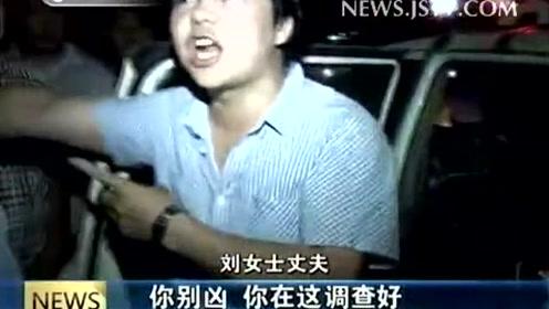 宝马车撞到行人 民警执法遭扇耳光
