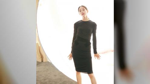 明星张钧甯一身轻纱礼服,长发低束,尽显成熟干练