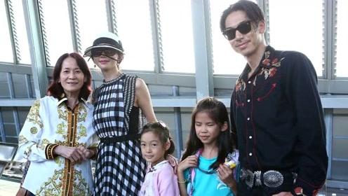 林志玲夫妇婚礼后现身高铁站 手捧婚礼花束露甜蜜笑容