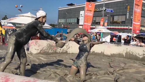 韩国最奇葩节日,每年200万游客参加,不论男女相互泼泥浆!