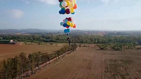 疯狂男子用50个氢气球,把自己带上200米高空,胆子太大了!