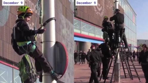 8岁环保少女爬上灯柱抗议 结果被警方救了下来