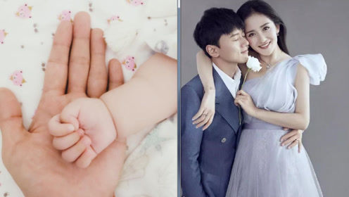 张杰陪在女儿身边晒照分享幸福 大手托小手画面很温馨