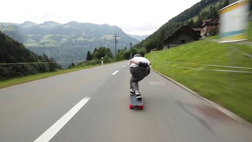 小伙挑战110公里的长板速降,耳边风声呼啸,速度赶超汽车!