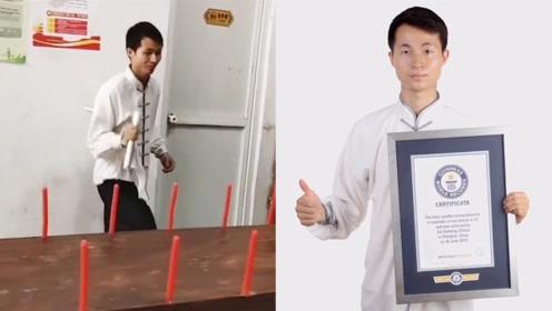 中国小伙苦练双节棍10年,53秒灭52根蜡烛,创世界新纪录