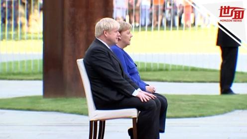 默克尔会见鲍里斯 再次坐着迎接外宾