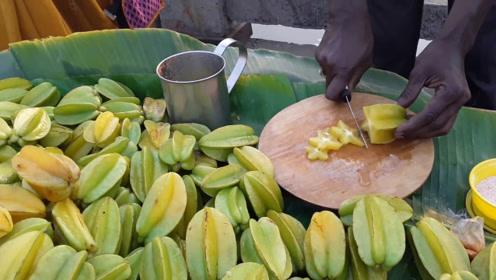印度人吃杨桃的方法厉害了!要撒上调料面儿拌一拌,看完你想吃吗
