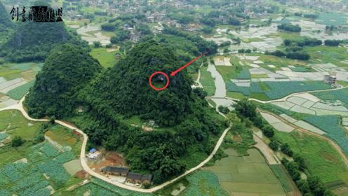 """航拍神秘的悬崖山洞,靠近后发现里面有""""东西""""这里必定不一般"""