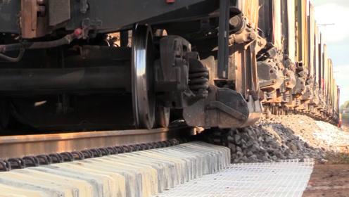火车轨道上的石子,为什么铺的那么均匀,又怎么铺上去的?