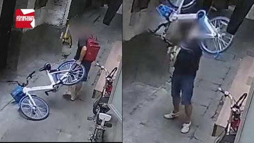广州一男子在小巷狂摔共享单车:40秒时间,摔车4次踩踏3次