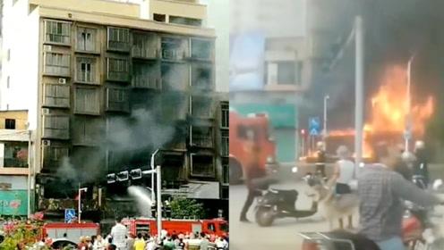 广西梧州一店铺广告牌起火,爆炸声噼里啪啦,浓烟熏黑整栋楼