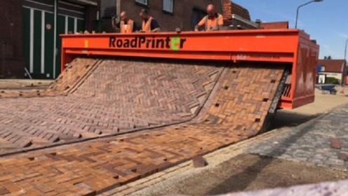 别国创造自动铺路机,车边动边铺路,看完令人刮目相看