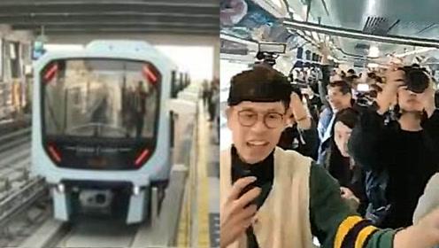 澳门正式迈入轻轨时代!首条轻轨线通车 市民在车厢内欣喜欢呼