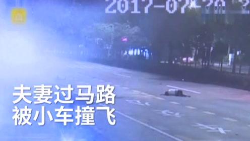危险驾驶的小车撞飞年轻夫妻