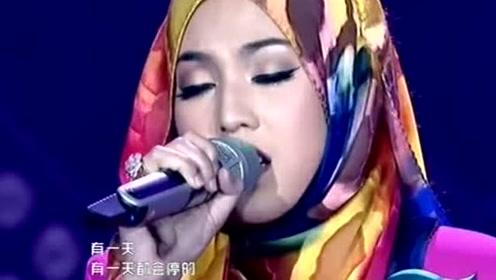 """马来西亚总理称她为""""国宝"""",茜拉中文演唱《记得》"""