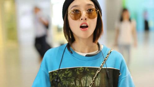 唐艺昕现身机场未见张若昀,鲜红色的指甲特别抢镜
