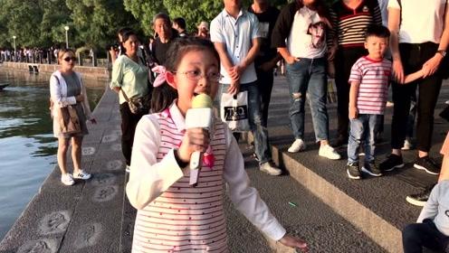 12岁女孩歌声如天籁 西湖边唱歌是家庭作业