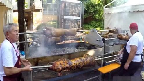 国外街头的烤全猪 上百斤的猪直接烧烤吃 太爽了!