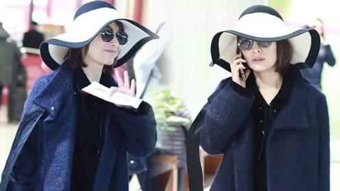 吴昕造型飘逸时尚感满分 黑超遮面难掩笑意显可爱