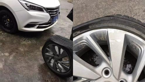 """车主驾驶途中被道路上的深坑""""咬""""停 车胎直接报废"""