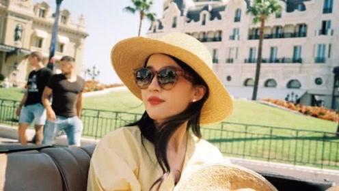 刘亦菲晒超美旅游私房照 纱扇轻掩发丝轻扬人比花娇