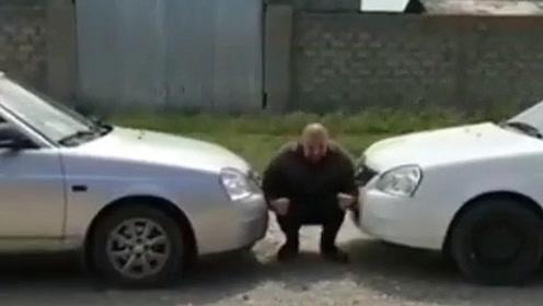 俄罗斯壮汉挑战两辆汽车同时挤压自己,战斗民族就是彪悍