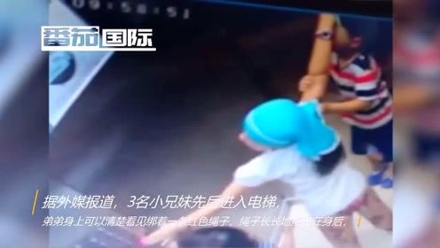 男孩脖子套绳被电梯吊起 生死关头姐姐10秒救下